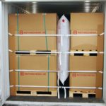 Aufnahme einer Palette in einem Container mit Staupolster, Gurtbändern und Mushrooms gesichert.